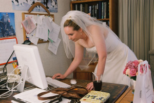 bride-checking-wedding-planning-websites-by-madprime